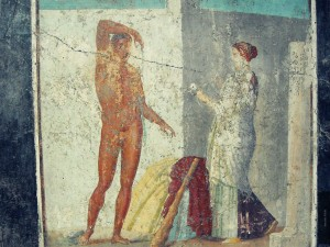 Ariadne handing Theseus a ball of Thread