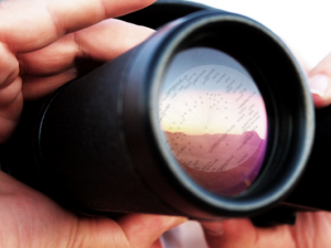 The Semantic Web Through the Eyes of a Content Writer Featured Image Binoculars with Text cloud